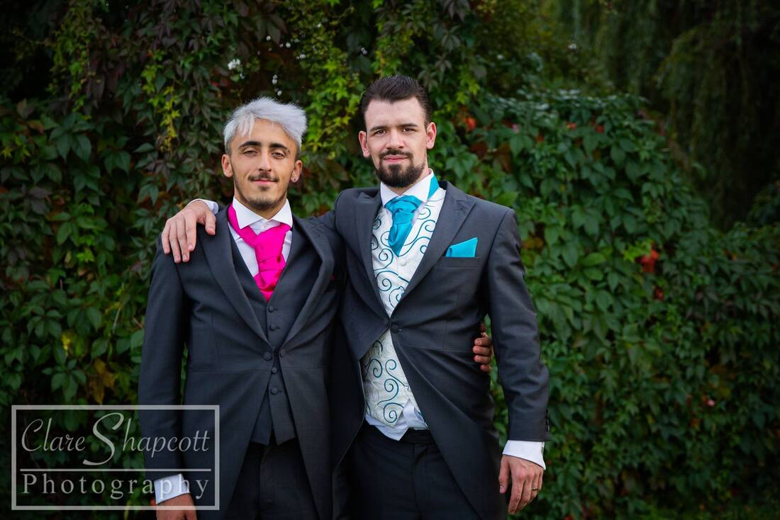 Groom with best man with beards in pink and blue