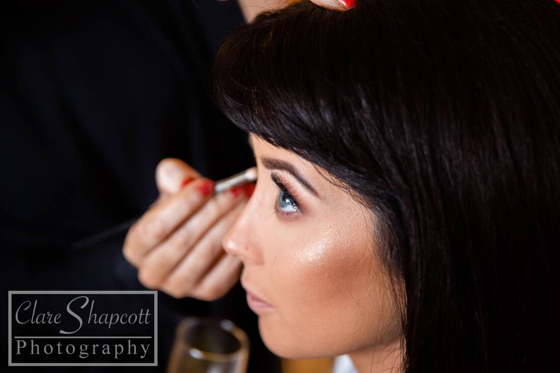 Professional bridal preparation photograph close up of face and makeup