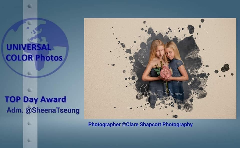 Award winning photograph of two girls in blue dresses next to each other on canvas, with paint splash effect.