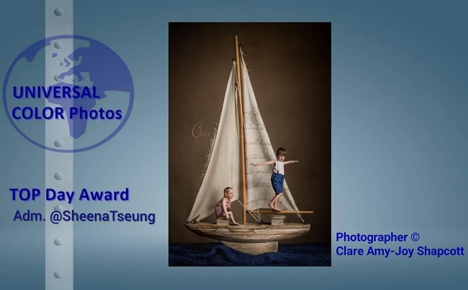 Award won by Clare Shapcott for her creative photograph of two children playing atop a model boat.