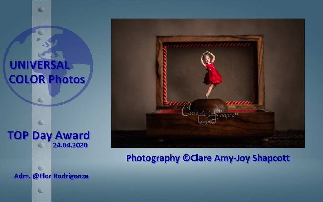 Award won by Clare Shapcott by 'Universal color photos' for her illustrative portrait of a girl in red dress dancing inside music box.