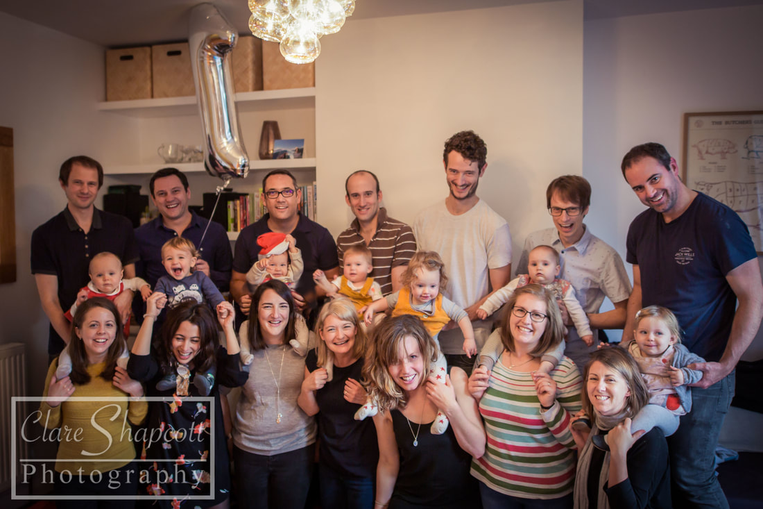 Group photograph of babies and parents at first birthday party