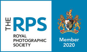 The Royal photographic society blue and white logo.