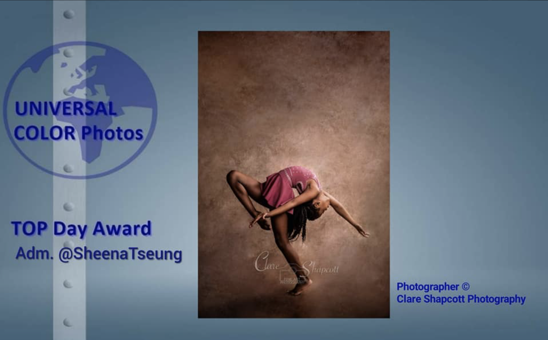 Award winning photograph of young dancer girl bending backwards in pink outfit.