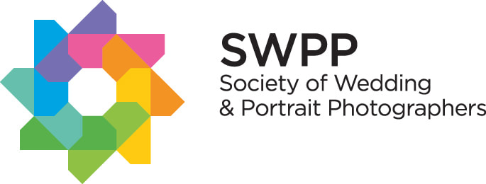 Rainbow aperture logo of the society of wedding and portrait photographers