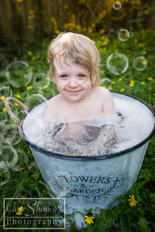 Beautiful photograph of child in flower tub outside