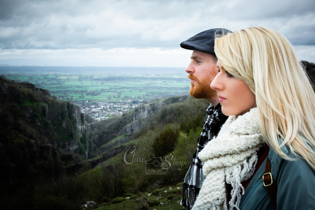 Cover art for female and male musicians looking across a mountain with valley behind them.